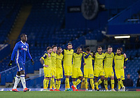 Kurt Zouma of Chelsea walks past Oxford United players to take his first penalty during Chelsea's 13-12 penalty shootout win as a record 34 spot-kicks are taken during the The Checkatrade Trophy match between Chelsea U23 and Oxford United at Stamford Bridge, London, England on 8 November 2016. Photo by Andy Rowland.