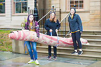 Alexandria Christie,'20, Rebecca Sock,'20, and Kayla Campanelli,'20, haul a rug to the trash bins at the Redwood Library in Newport as they take part in Salve's Exploration Day of Service