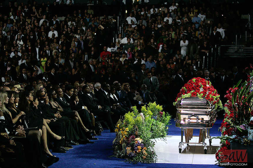 LOS ANGELES,CA - JULY 7,2009: A rose covered coffin holding the remains of Michael Jackson rests in the front of stage during Michael Jackson memorial at Staples Center, July 7, 2009. A rose covered coffin holding the remains of Michael Jackson rests in the front of stage. Jackson, 50, died June 25th, after suffering an apparent cardiac arrest at his home in Los Angeles. Jackson is survived by his three children; son, Prince Michael Jr., daughter, Paris Michael Katherine, and son Prince Michael II.  Michael Jackson sold more than 750 million records, had 13 number one singles, more than any other male artist, and is one of the few artists to have been inducted into the Rock and Roll Hall of Fame twice; once as a member of The Jackson 5 in 1997 and later as a solo artist in 2001.