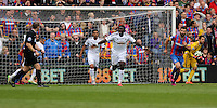 Pictured: Bafetimbi Gomis of Swansea protest to match referee C Pawson (L)<br />