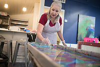 """Andrea Jones of Rogers creates a design for a scarf she will dye using a water marbling technique, Sunday, January 12, 2020 during a water marbling class at Art & Soul Studios NWA in Rogers. Check out nwaonline.com/200113Daily/ for today's photo gallery.<br /> (NWA Democrat-Gazette/Charlie Kaijo)<br /> <br /> Marie Haley, artist and owner of Art & Soul Studios, lead a class to show art enthusiasts an innovative approach to dying fabrics. The water marbling technique is from the 15th century. Artists drop paints into a bath of seaweed solution that rises to the top. Afterwards, they use tools to create designs with the paint before dipping their fabric into the bath. <br /> <br /> Visitors who tried the art style shared their experience of the process saying, """"This is satisfying because you can't mess up. It doesn't take that long. You get instant gratification."""" And """"What it turns out to be might not be what you expected."""""""
