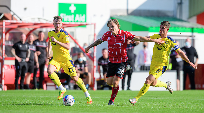 Lincoln City's Harry Anderson vies for possession with Oxford United's Cameron Brannagan<br /> <br /> Photographer Chris Vaughan/CameraSport<br /> <br /> The EFL Sky Bet League One - Saturday 12th September 2020 - Lincoln City v Oxford United - LNER Stadium - Lincoln<br /> <br /> World Copyright © 2020 CameraSport. All rights reserved. 43 Linden Ave. Countesthorpe. Leicester. England. LE8 5PG - Tel: +44 (0) 116 277 4147 - admin@camerasport.com - www.camerasport.com - Lincoln City v Oxford United