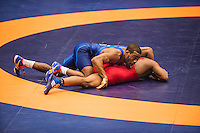 Jordan Burroughs of the United States (cq, in blue), wrestles Francisco Daniel Soler Tanco of Puerto Rico in the quarter final round of the Pan American Championships at Dr. Pepper Arena in Frisco, Texas, Saturday, February 27, 2015. Burroughs went on to win the match 10-0 and eventually win gold at the event.<br /> <br /> Photo by Matt Nager