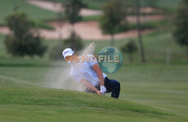 Romain Wattel (FRA) chips out of a bunker at the 18th green during Day 3 of the Open de Espana at Real Club De Golf El Prat, Terrasa, Barcelona, 7th May 2011. (Photo Eoin Clarke/Golffile 2011)