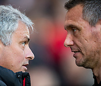 Jose Mourinho Manager of Manchester United & fourth official Andre Marriner during the Premier League match between Bournemouth and Manchester United at the Goldsands Stadium, Bournemouth, England on 18 April 2018. Photo by Andy Rowland.
