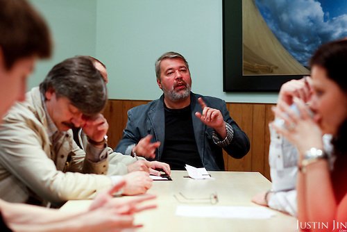 Chief editor Dmitry Muratov holds a daily news meeting at the office of Novaya Gazeta newspaper in Moscow. Novaya Gazeta is one of the few remaining independent media outlets in Russia that dare to challenge the Kremlin, but it has paid a heavy price for its courage. Anna Politkovskaya, the newspaper's most prominent journalist, was gunned down in her apartment block in Moscow in 2006.   ..Picture by Justin Jin.