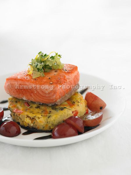 Salmon with polenta cake, grapes, sauteed onion