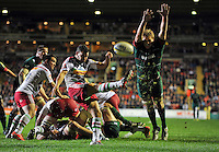 Karl Dickson of Harlequins box-kicks the ball as Jamie Gibson of Leicester Tigers looks to charge him down. Aviva Premiership match, between Leicester Tigers and Harlequins on October 10, 2014 at Welford Road in Leicester, England. Photo by: Patrick Khachfe / JMP