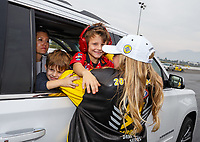 Nov 12, 2017; Pomona, CA, USA; NHRA top fuel driver Brittany Force (right) celebrates with the children of sister Ashley Force Hood after clinching the 2017 NHRA top fuel dragster world championship during the Auto Club Finals at Auto Club Raceway at Pomona. Mandatory Credit: Mark J. Rebilas-USA TODAY Sports