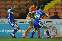 Blackpool's Armand Gnanduillet under pressure from Gillingham's Thomas O'Connor (right) and Barry Fuller<br /> <br /> Photographer Kevin Barnes/CameraSport<br /> <br /> The EFL Sky Bet League One - Blackpool v Gillingham - Tuesday 11th February 2020 - Bloomfield Road - Blackpool<br /> <br /> World Copyright © 2020 CameraSport. All rights reserved. 43 Linden Ave. Countesthorpe. Leicester. England. LE8 5PG - Tel: +44 (0) 116 277 4147 - admin@camerasport.com - www.camerasport.com