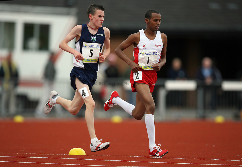Photo: Rich Eaton...Schools International Athletic Board, Track & Field International Match, Newport. 21/07/2007. Abdirisak Ahmed #1 of England leads Chris O'Hare of Scotland and goes on to win gold in the boys 3000m.