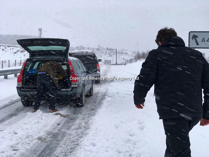 Cars face difficulty in travelling on the A465 Heads of Valleys road near Tredegar in south Wales, UK. Sunday 10 December 2017.