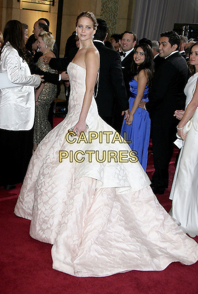 Jennifer Lawrence (wearing Dior Haute Couture).85th Annual Academy Awards held at the Dolby Theatre at Hollywood & Highland Center, Hollywood, California, USA..February 24th, 2013.oscars full length white pale pink side strapless dress gown voluminous clutch bag full-tiered skirt.CAP/ADM.©AdMedia/Capital Pictures.