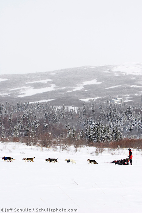 Aliy Zirkle runs on the slough a mile after leaving Unalakleet during Iditarod 2008