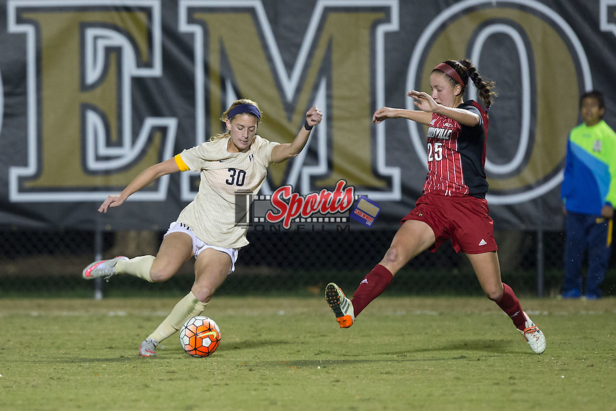 Sarah Medina (30) of the Wake Forest Demon Deacons keeps the ball away from Caroline Kimble (25) of the Louisville Cardinals during first half action at Spry Soccer Stadium on October 31, 2015 in Winston-Salem, North Carolina.  The Demon Deacons defeated the Cardinals 2-1.  (Brian Westerholt/Sports On Film)