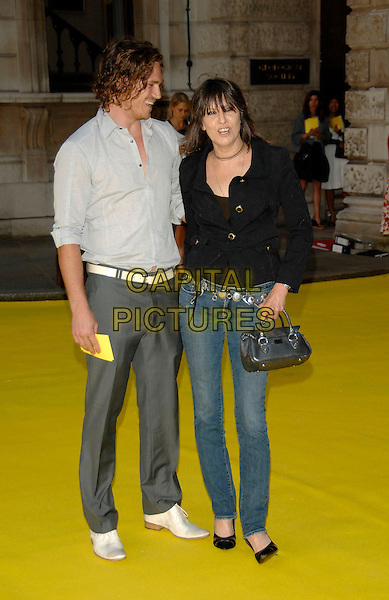 CHRISSIE HYNDE & Beou .Royal Academy Summer Exhibition 2007 arrivals, at the Royal Academy of Arts, Piccadilly, London, England..June 6th, 2007 .full length skinny jeans denim black jacket silver clutch purse belt grey gray trousers.CAP/PL.©Phil Loftus/Capital Pictures