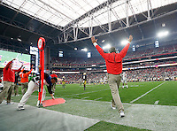 Ohio State Buckeyes head coach Urban Meyer raises his arms in victory after a Notre Dame fumble near the end of Ohio State's 44-28 win in the Battlefrog Fiesta Bowl at University of Phoenix Stadium in Glendale, Arizona on Jan. 1, 2016. (Adam Cairns / The Columbus Dispatch)