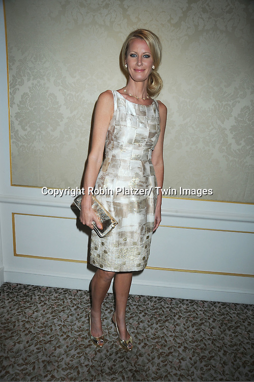Sandra Lee in Carmen Marc Valvo white and gold dress attending The Musuem of The Moving Image Gala honoring Brian Williams of NBC News and Kenneth Lowe of Scripps Networks Interactive at The St Regis Hotel in New York City on June 2, 2011.