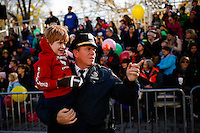 A New York Police Officers holds a relative during the 89th Macy's Thanksgiving Annual Day Parade in the Manhattan borough of New York.  11/26/2015. Eduardo MunozAlvarez/VIEWpress