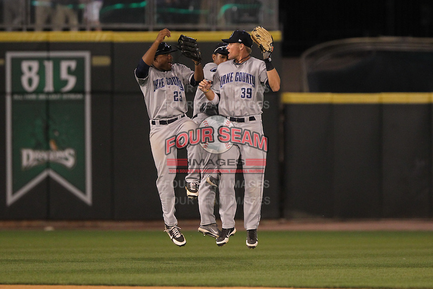Lake County Captains outfielders Bryson Myles #23, Luigi Rodriguez #6 and Jordan Smith #39 celebrate the victory following a game against the Dayton Dragons at Fifth Third Field on June 25, 2012 in Dayton, Ohio. Lake County defeated Dayton 8-3. (Brace Hemmelgarn/Four Seam Images)