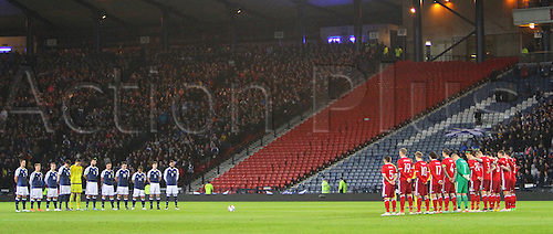 29.03.2016. Hampden Park, Glasgow, Scotland. International Football Friendly Scotland versus Denmark.  Both teams observe the minutes silence for the victims of the recent terrorist attacks worldwide