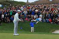 Nacho Elvira (ESP) on the 18th green to cheers from the supporters during Round 4 of the Open de Espana 2018 at Centro Nacional de Golf on Sunday 15th April 2018.<br /> Picture:  Thos Caffrey / www.golffile.ie<br /> <br /> All photo usage must carry mandatory copyright credit (&copy; Golffile | Thos Caffrey)