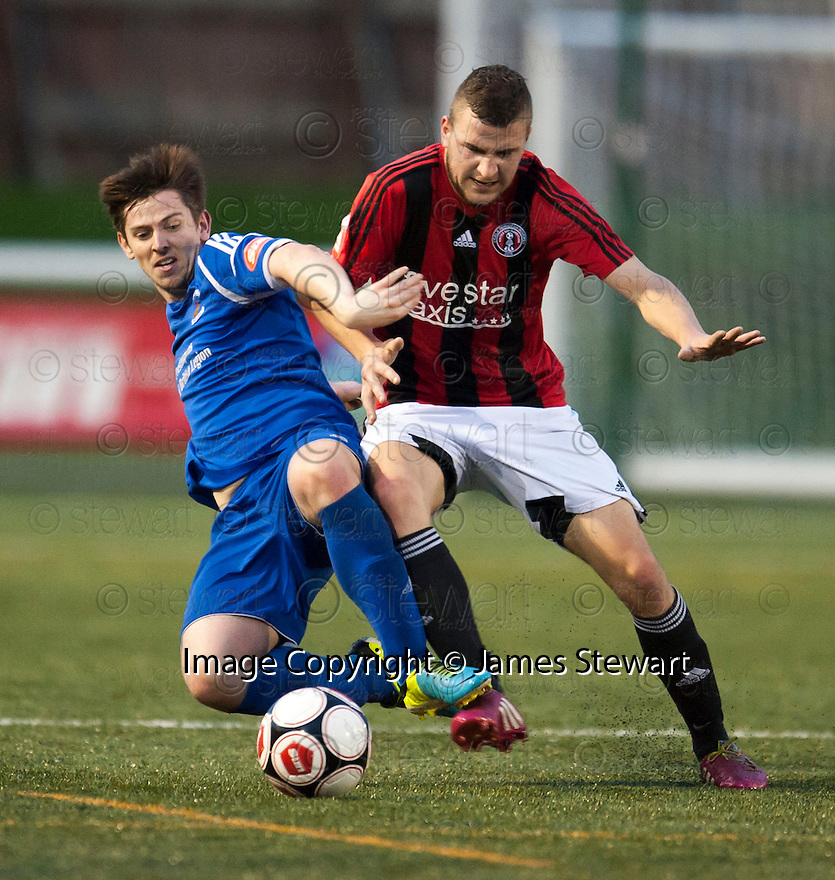 Preston's Ryan Strachan and Gala's Billy Miller challenge for the ball.