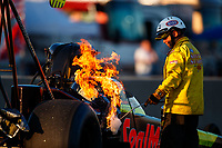 Jul 8, 2017; Joliet, IL, USA; A member of the NHRA safety safari extinguishes a fire in the engine on the dragster of top fuel driver Troy Coughlin Jr during qualifying for the Route 66 Nationals at Route 66 Raceway. Mandatory Credit: Mark J. Rebilas-USA TODAY Sports