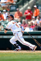 Baltimore Orioles outfielder Nate McLouth #9 hits a home run during a Spring Training game against the New York Mets at Ed Smith Stadium on March 30, 2013 in Sarasota, Florida.  (Mike Janes/Four Seam Images)