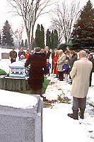 Family paying last respects to great grandma at grave.  Minneapolis Minnesota USA