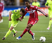 Seattle Sounders FC forward Mike Fucito, left battles Chicago Fire defender Cory Gibbs for the ball during play between the Seattle Sounders FC and the Chicago Fire in the U.S. Open Cup Final at CenturyLink Field in Seattle Tuesday October 4, 2011. Seattle won the game 2-0 to win its third U.S. Open Cup.