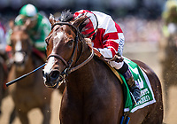 ELMONT, NY - JUNE 10: Songbird #5 with Mike Smith wins the Ogden Phipps Stakes at Belmont Park on June 10, 2017 in Elmont, New York. (Photo by Alex Evers/Eclipse Sportswire/Getty Images)