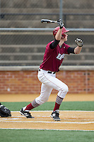 Patrick McColl (31) of the Harvard Crimson follows through on his swing against the Wake Forest Demon Deacons at David F. Couch Ballpark on March 5, 2016 in Winston-Salem, North Carolina.  The Crimson defeated the Demon Deacons 6-3.  (Brian Westerholt/Four Seam Images)