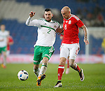 Conor McLaughlin of Northern Ireland battles David Cotterill of Wales during the international friendly match at the Cardiff City Stadium. Photo credit should read: Philip Oldham/Sportimage
