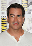 Rob Riggle arriving at the Let's Be Cops Panel at Comic-Con 2014  at the Hilton Bayfront Hotel in San Diego, Ca. July 25, 2014.