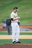 Wake Forest Demon Deacons relief pitcher Griffin Roberts (43) checks the baseball during the game against the Georgia Tech Yellow Jackets at David F. Couch Ballpark on March 26, 2017 in  Winston-Salem, North Carolina.  The Demon Deacons defeated the Yellow Jackets 8-4.  (Brian Westerholt/Four Seam Images)