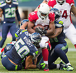 Arizona Cardinals running back Stephan Taylor (30) can't find any running room against Seattle Seahawks strong safety Kam Chancellor   (31) and linebacker K.J. Wright (50) and Bruce Irvin (51)at CenturyLink Field in Seattle, Washington on November 23, 2014. The Seahawks beat the Cardinals 19-3.   ©2014. Jim Bryant Photo. All Rights Reserved.