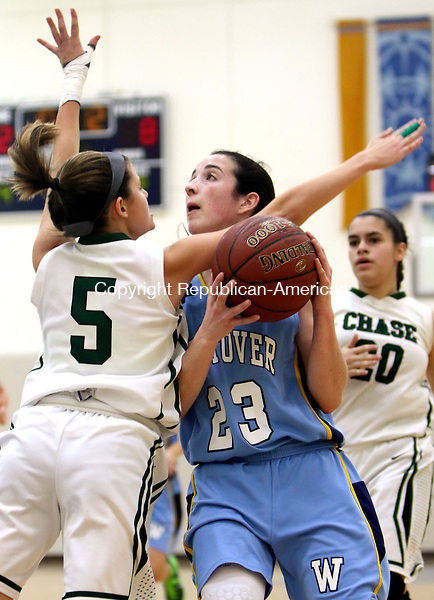 MIDDLEBURY CT. 16 January 2015-011616SV16-#23 Gabriela Dunn of Westover School drives to the hoop as #5 Morgan Maisto of Chase Collegiate School defends during basketball action in Middlebury Saturday. <br /> Steven Valenti Republican-American