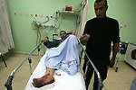A wounded Palestinian man receives treatment at the European hospital in the southern Gaza Strip town of Khan Younis, Thursday, Oct. 7, 2010. An Israeli Bullet  wounded a Palestinian man in the southern Gaza Strip, medical officials at the European hospital said.. Photo by Khaled Khaled