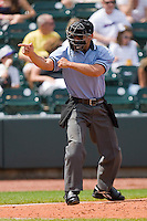 Home plate umpire Joey Amaral makes a strike call during a Carolina League game between the Wilmington Blue Rocks and the Winston-Salem Dash at the BB&T Park April25, 2010, in Winston-Salem, North Carolina.  Photo by Brian Westerholt / Four Seam Images