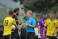Referee Sean Reilly yellow cards Stevan Markovic during the ISPS Handa Premiership football match between Team Wellington and Wellington Phoenix Reserves at David Farrington Park in Wellington, New Zealand on Sunday, 17 November 2019. Photo: Dave Lintott / lintottphoto.co.nz