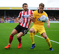 Lincoln City's Sean Long vies for possession with Morecambe's Patrick Brough<br /> <br /> Photographer Andrew Vaughan/CameraSport<br /> <br /> The EFL Sky Bet League Two - Lincoln City v Morecambe - Saturday August 12th 2017 - Sincil Bank - Lincoln<br /> <br /> World Copyright &copy; 2017 CameraSport. All rights reserved. 43 Linden Ave. Countesthorpe. Leicester. England. LE8 5PG - Tel: +44 (0) 116 277 4147 - admin@camerasport.com - www.camerasport.com