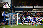 The visitors defend a first-half corner as Ipswich Town (in blue) play Oxford United in a SkyBet League One fixture at Portman Road. Both teams were in contention for promotion as the season entered its final months. The visitors won the match 1-0 through a 44th-minute Matty Taylor goal, watched by a crowd of 19,363.