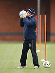 Kenny McDowall kisses the match ball