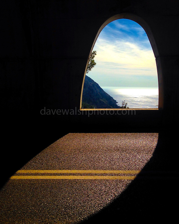 View of the Mediterranean Sea through a road tunnel in Mallorca, near Estellencs.