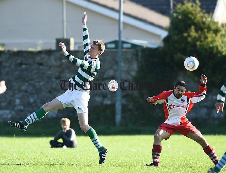 Eoin Brennan of Sporting Ennistymon in action against Abner Cordieo of  Corofin Harps during their match in Corofin. Photograph by John Kelly.
