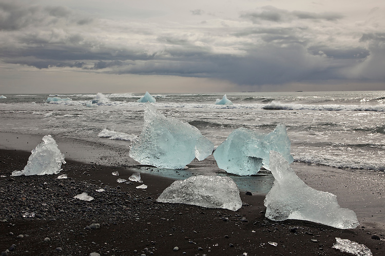 Stranded icebergs on the black sand beach at Jokulsarlon