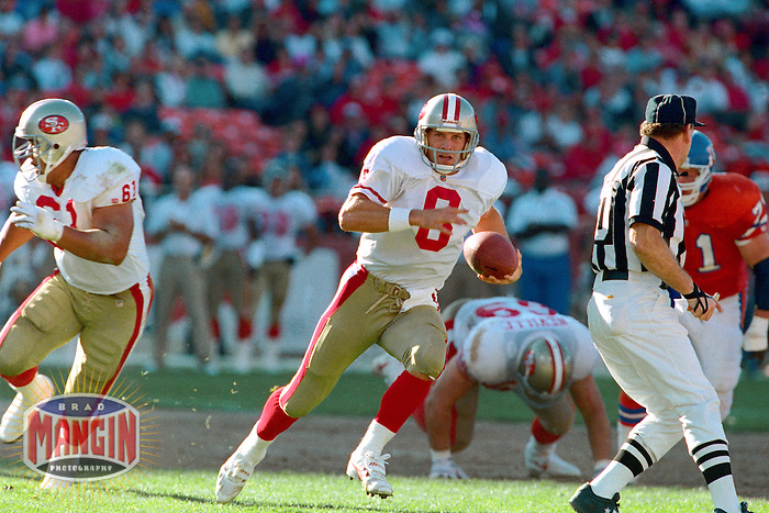 SAN FRANCISCO, CA - Quarterback Steve Young of the San Francisco 49ers in action during a game against the Denver Broncos at Candlestick Park in San Francisco, California in 1992. Photo by Brad Mangin