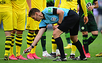 23rd May 2020, Volkswagen Arena, Wolfsburg, Lower Saxony, Germany; Bundesliga football,VfL Wolfsburg versus Borussia Dortmund; Referee Daniel Siebert marks the line for the defensive wall at a free kick