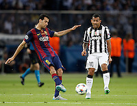 Calcio, finale di Champions League Juventus vs Barcellona all'Olympiastadion di Berlino, 6 giugno 2015.<br /> FC Barcelona's Sergio Busquets, left, is challenged by Juventus' Carlos Tevez during the Champions League football final between Juventus Turin and FC Barcelona, at Berlin's Olympiastadion, 6 June 2015. Barcelona won 3-1.<br /> UPDATE IMAGES PRESS/Isabella Bonotto